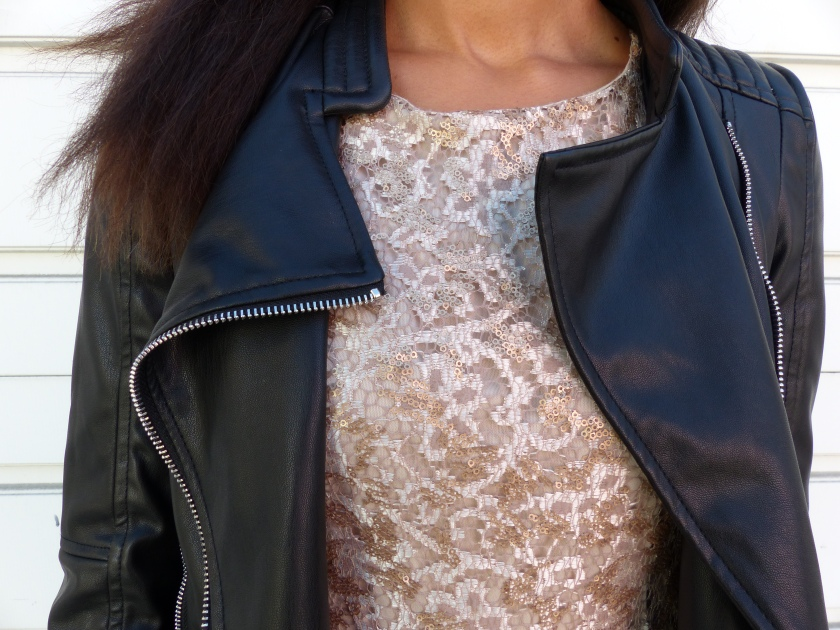 Amanda Garrigus moto jacket and gold dress close up