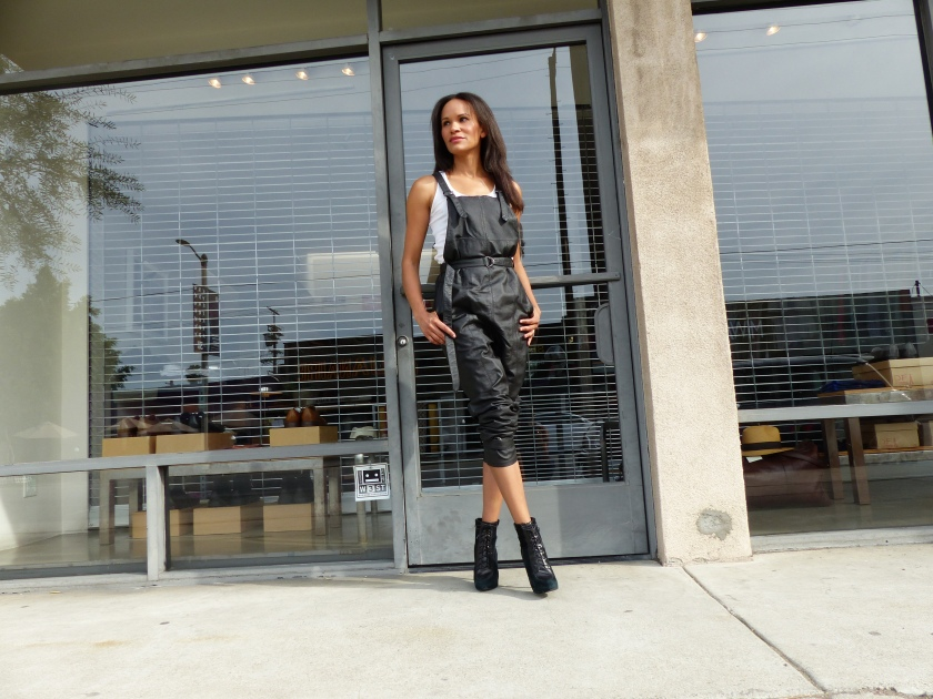 Amanda Luttrell Garrigus Black leather overalls crossed legs