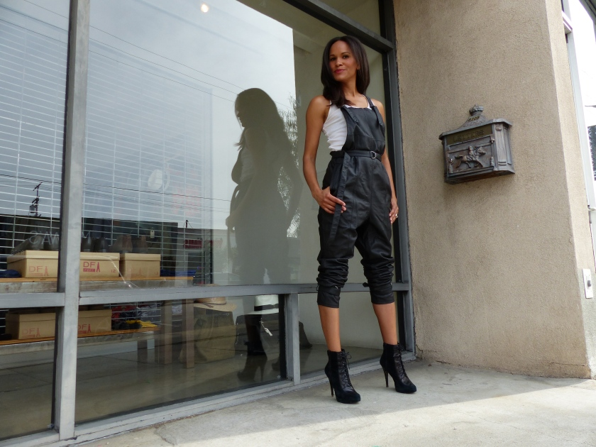 Amanda Luttrell Garrigus Black leather overalls hands in pockets