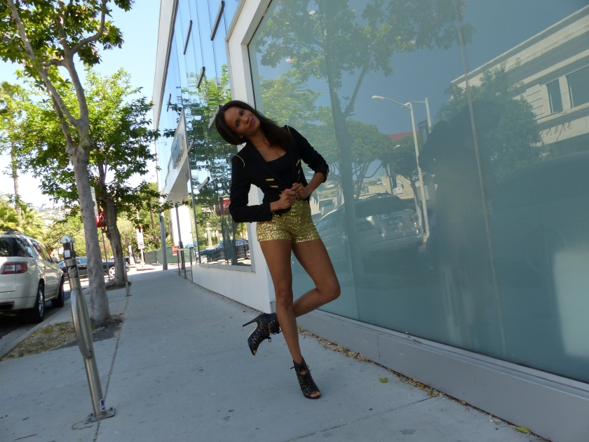Amanda Luttrell Garrigus Gold Shorts stork pose