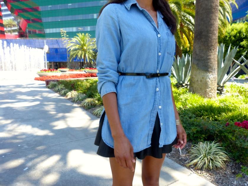 Amanda Garrigus belted denim shirt over black mini skirt