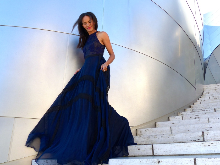 Amanda Garrigus in a Kevan Hall sleeveless gown
