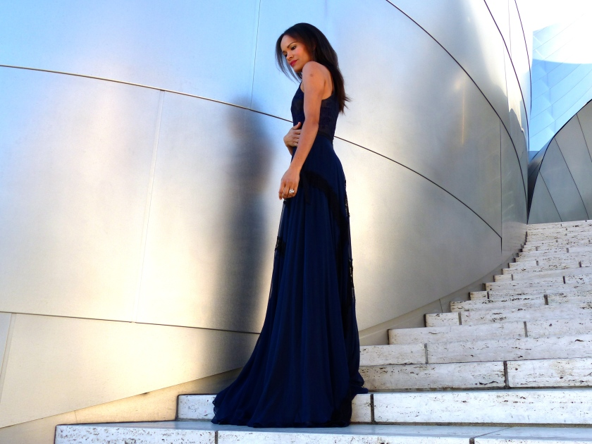 Amanda Garrigus in a long blue Kevan Hall dress