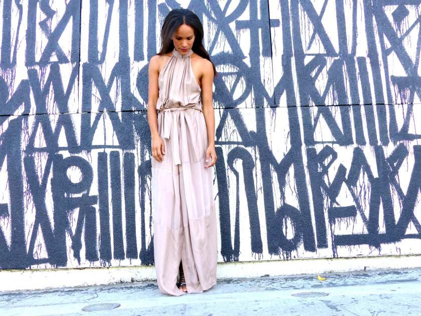 Amanda Garrigus in draped Olima neutral halter dress