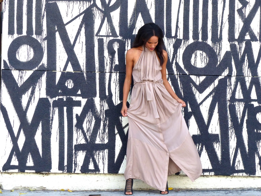 Amanda Garrigus wearing neutral halter dress at Retna wall
