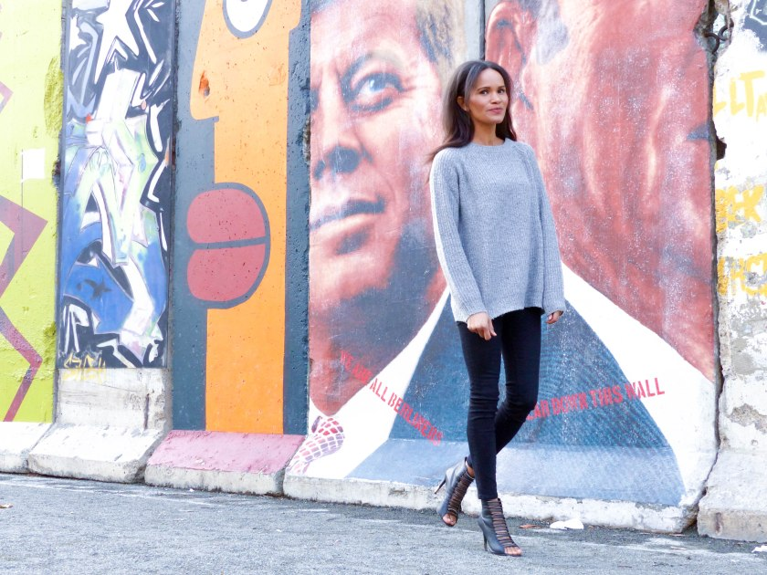 Amanda Garrigus Grey Sweater Balck Jean and the Berlin Wall LR