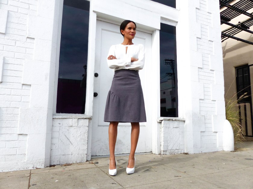 Amanda Garrigus in Cornell Collins skirt and white Aldo pump