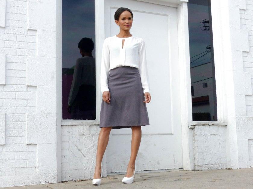 Amanda Garrigus in lavender knee length skirt and white blouse