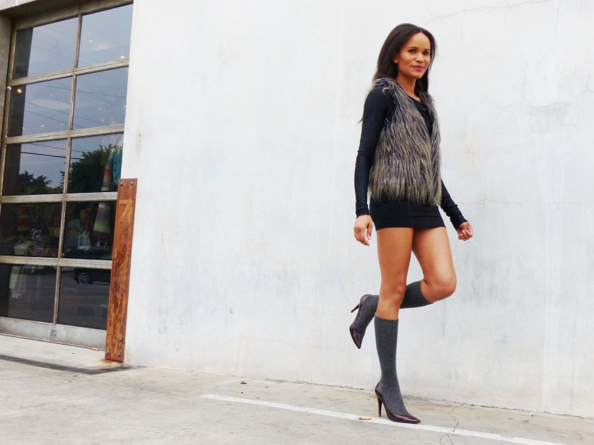Amanda Garrigus Faux Fur Vest and a grey wall and a pair of socks 1