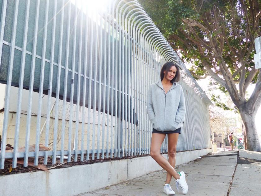 Amanda Garrigus in a grey cashmere hoodie