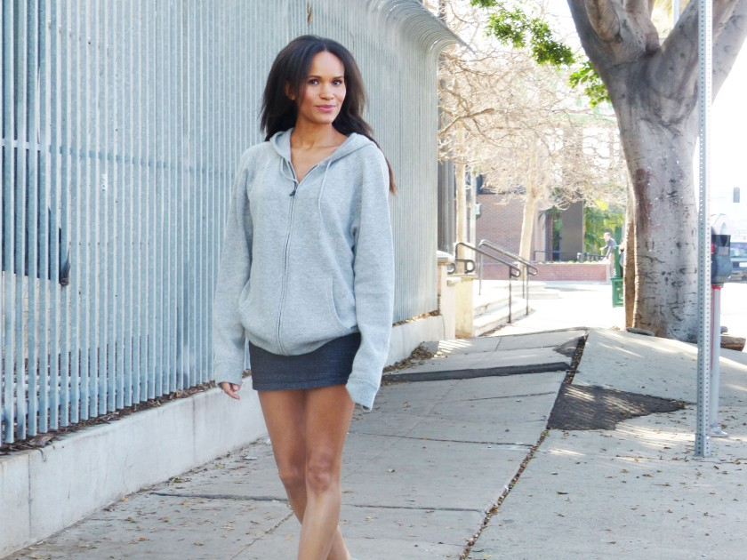 Amanda Garrigus wearing a cashmere hoodie and miniskirt