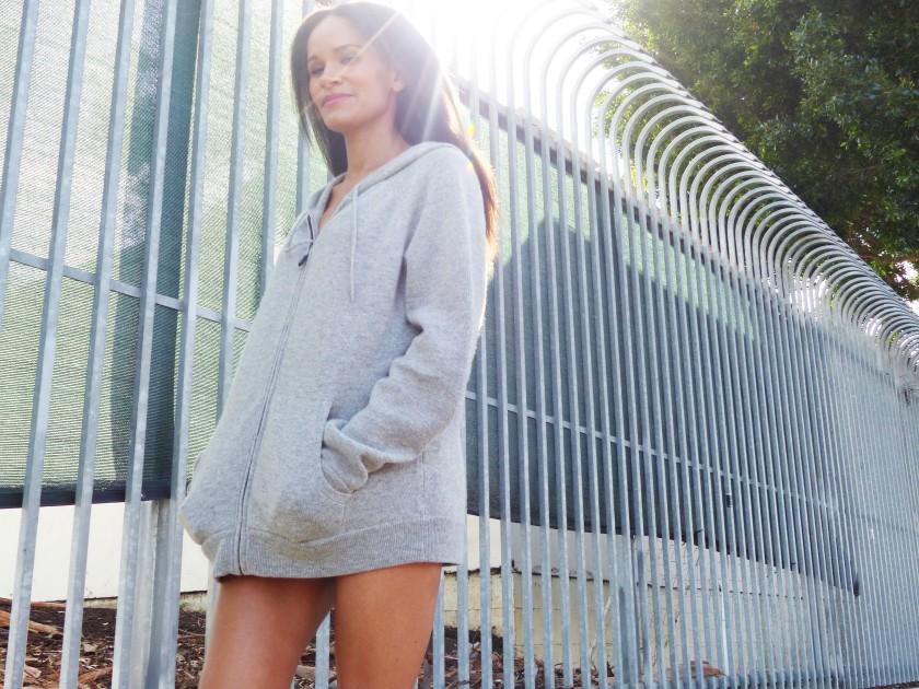 Amanda Garrigus wearing an oversized grey cashmere hoodie