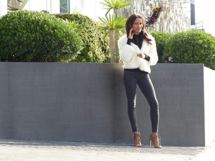 Amanda Garrigus in fuzzy white puffy jacket fringe high heel sandals and black denim