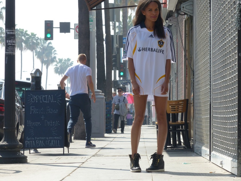 Amanda Garrigus wearing David Beckham jersey and sneakers