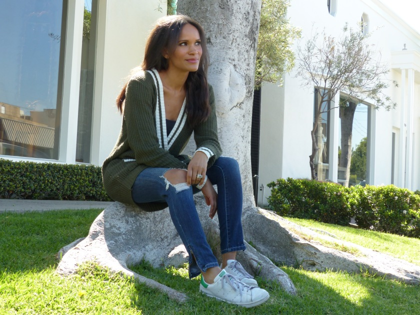 Amanda Luttrell Garrigus in a striped sweater and ripped jeans