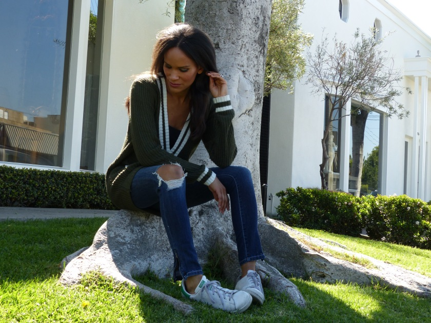 Amanda Luttrell Garrigus in striped sweater and ripped jeans