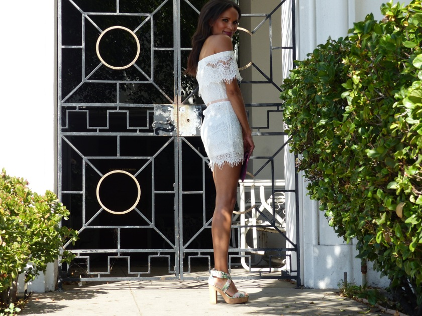Amanda Luttrell Garrigus white lace off the shoulder dress and cork floral sandal