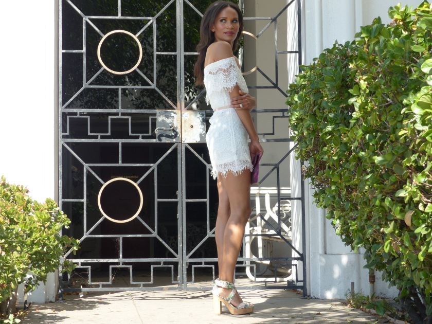 Amanda Luttrell Garrigus white lace off the shoulder dress and platform floral sandal