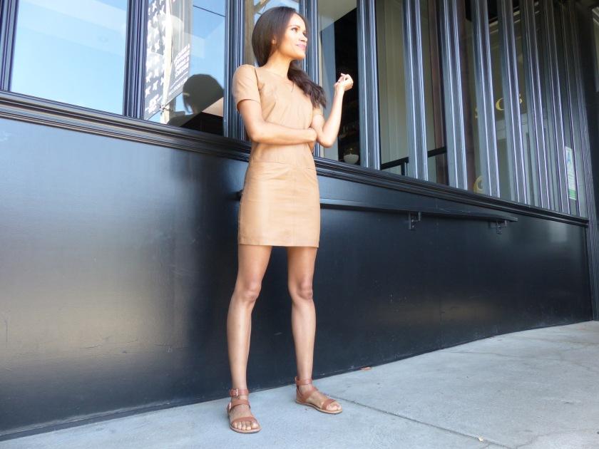 Amanda Garrigus wearing a nude leather shift dress