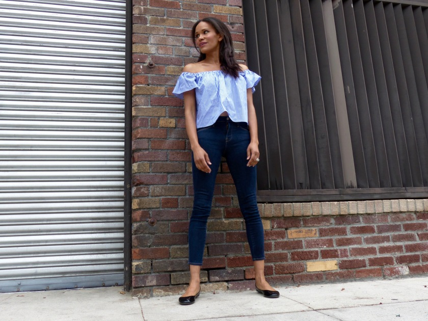 Amanda Luttrell Garrigus in a ballet flat and a blue stripe off the shoulder top