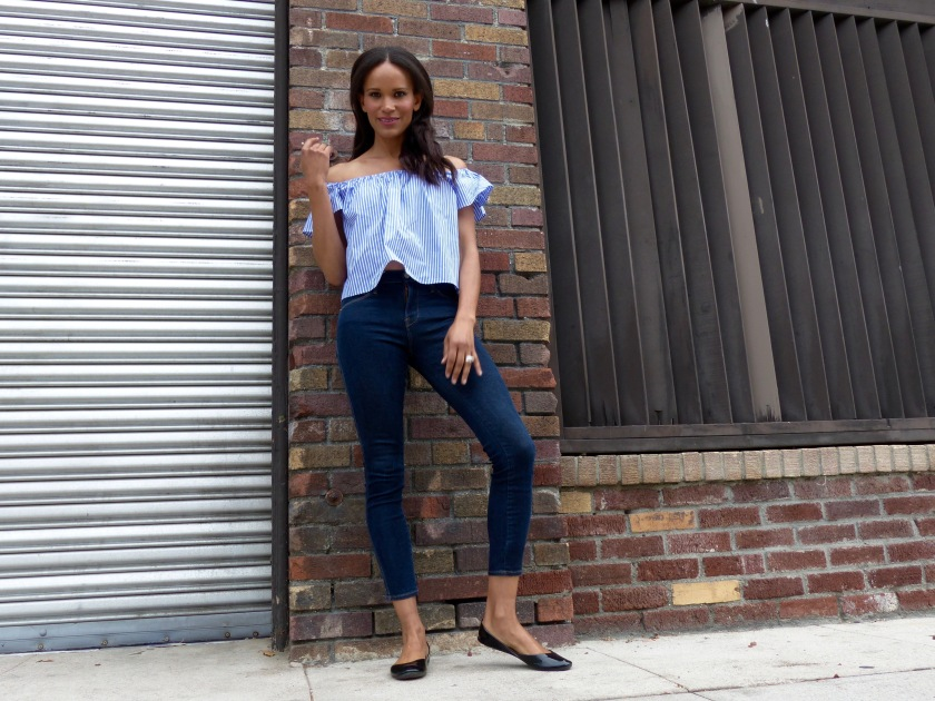 Amanda Luttrell Garrigus in an off the shoulder top, denim and flats