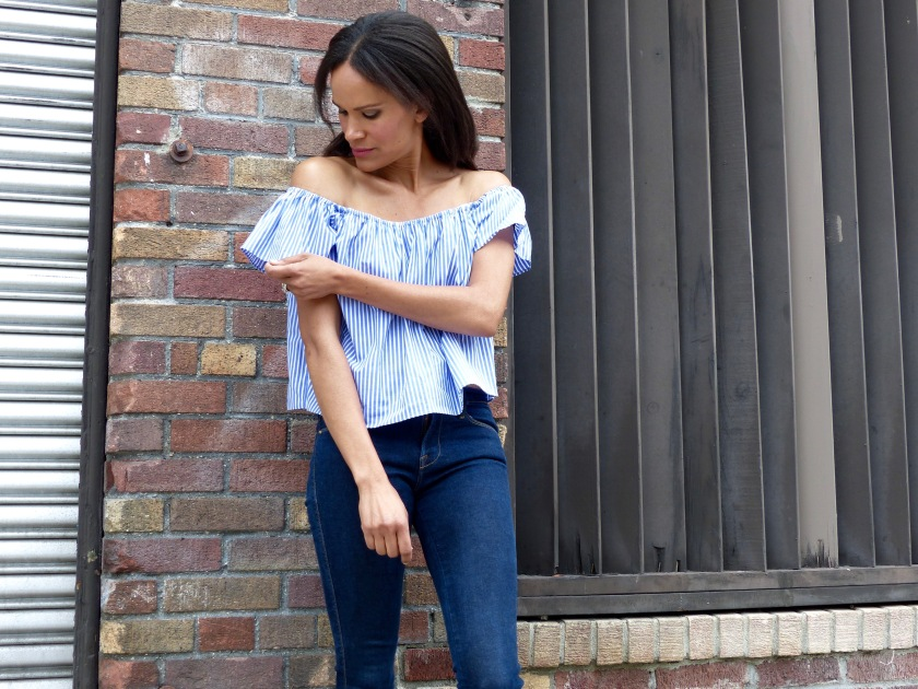 Amanda Luttrell Garrigus wearing a blue striped off the shoulder top
