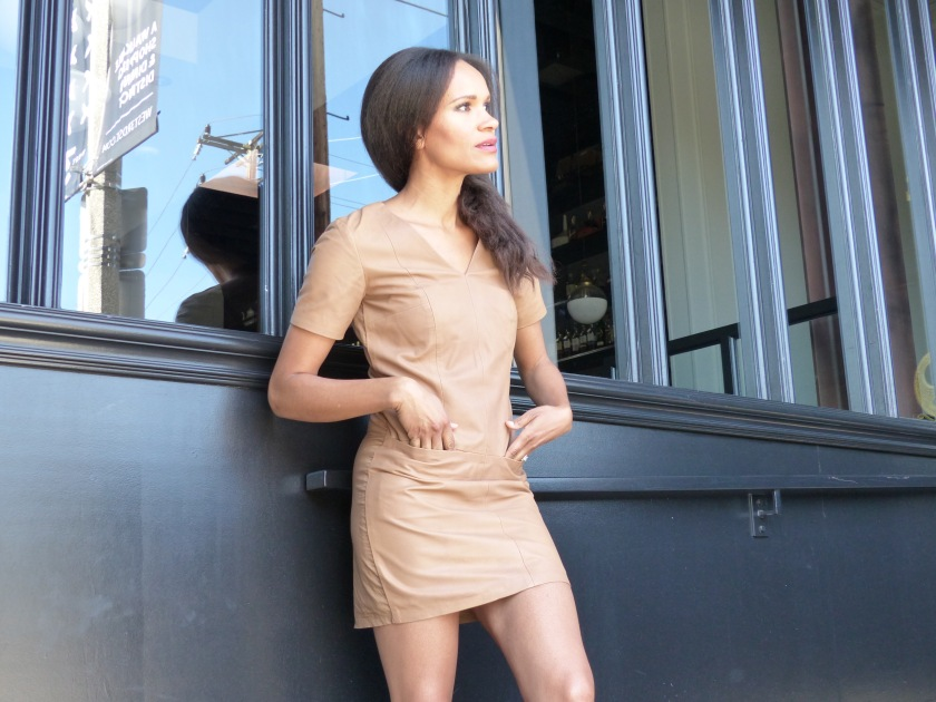 Amanda Luttrell Garrigus wearing a nude leather dress