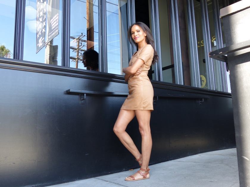 Amanda Luttrell Garrigus wearing a nude leather mini dress