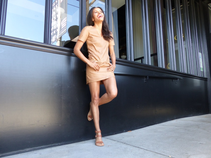 Amanda Luttrell Garrigus wearing a nude leather mini shift dress