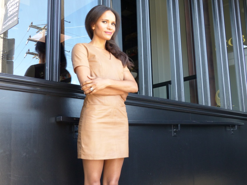 Amanda Luttrell Garrigus wearing a nude leather short sleeve dress