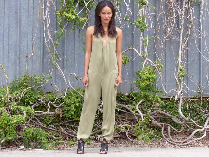 Amanda Garrigus wearing a pale green silk jumpsuit