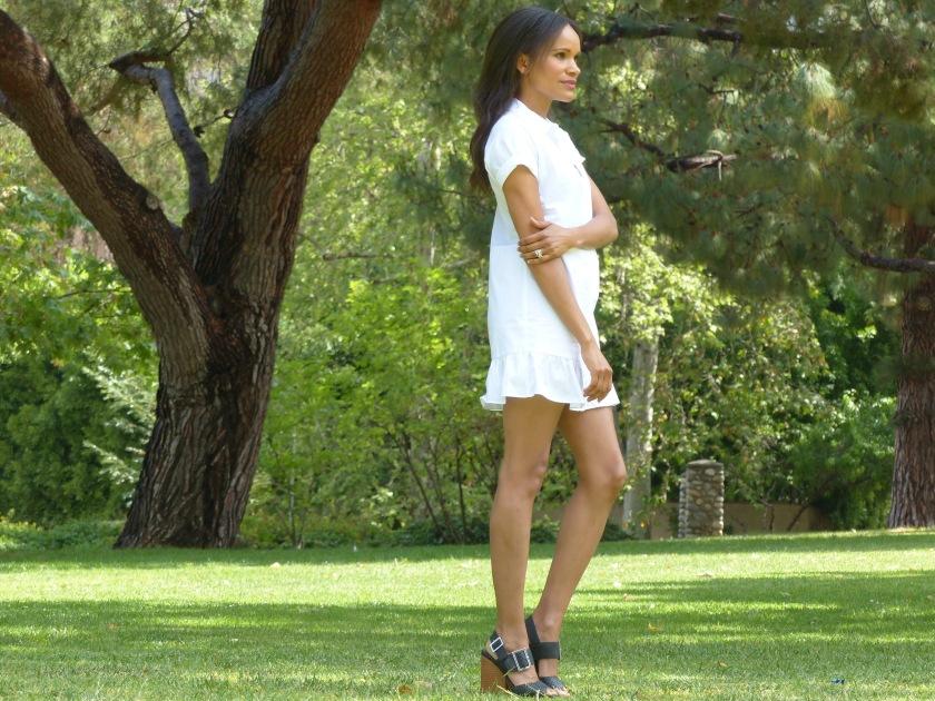 Amanda Garrigus wearing a white Zara cotton dress