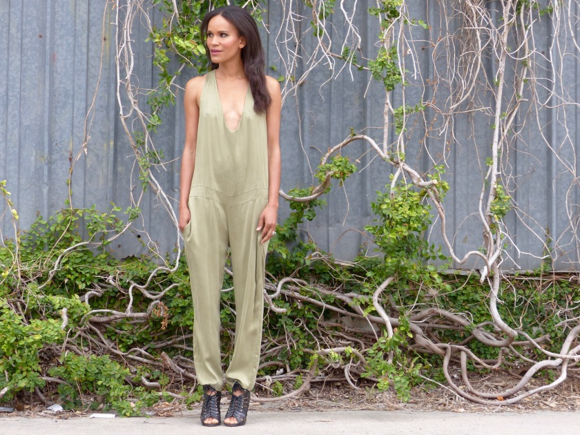 Amanda Garrigus wearing an olive silk jumpsuit