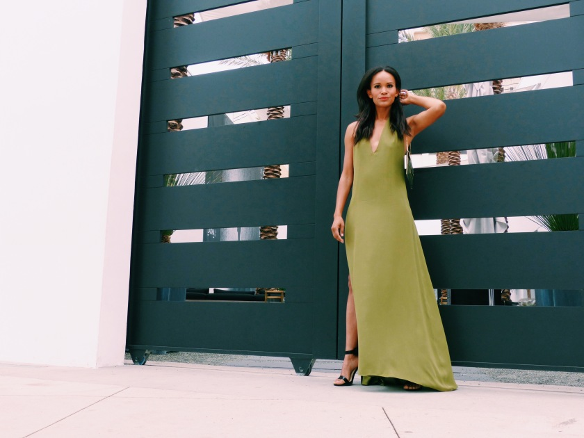 Amanda Luttrell Garrigus wearing Octavio Carlin's long green dress with high side slit and plunging back