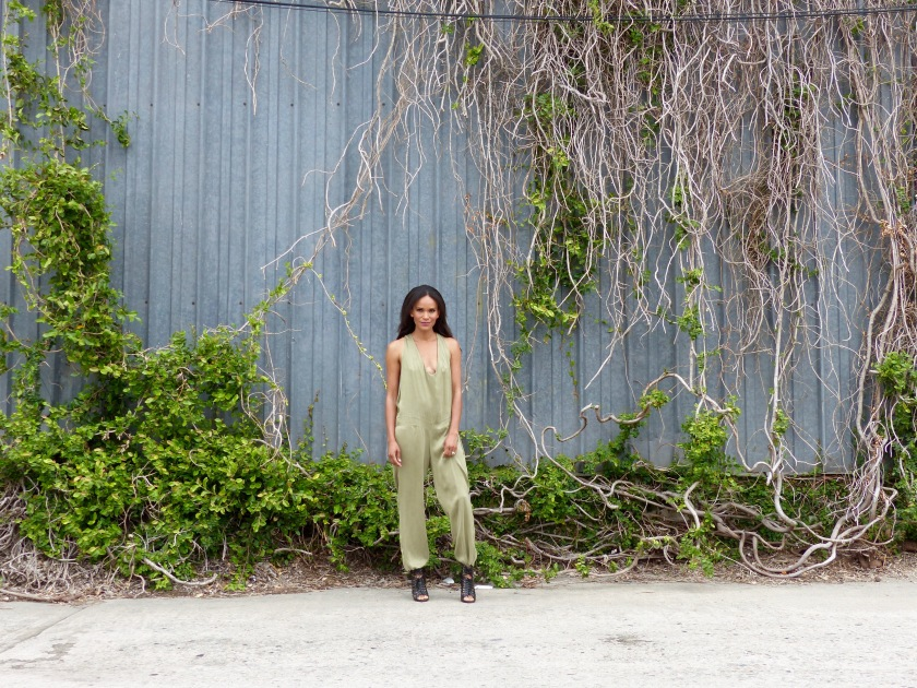 Amanda Luttrell Garrigus wearing an olive silk jumpsuit and Black Lace up boots