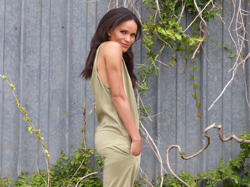 Amanda Luttrell Garrigus wearing an olive silk jumpsuit by Geren Ford