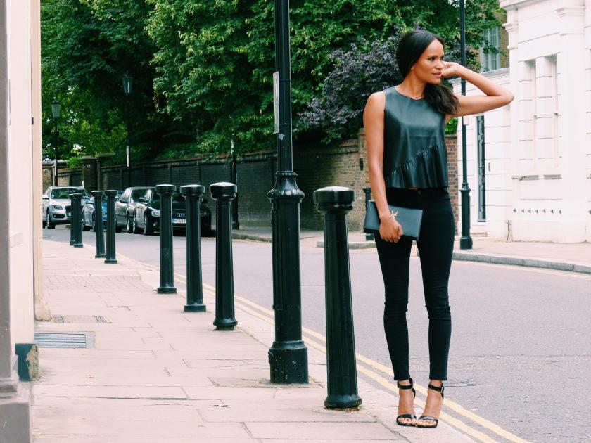 Amanda Garrigus carrying a YSL Clutch in London