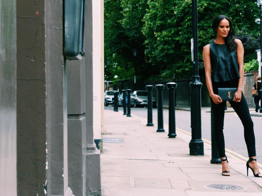 Amanda Luttrell Garrigus in vegan leather Zara tank Frame black denim and YSL clutch