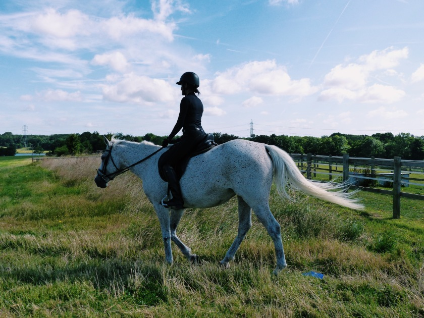 Amanda Luttrell Garrigus riding in the English countryside at the Four Seasons Hampshire