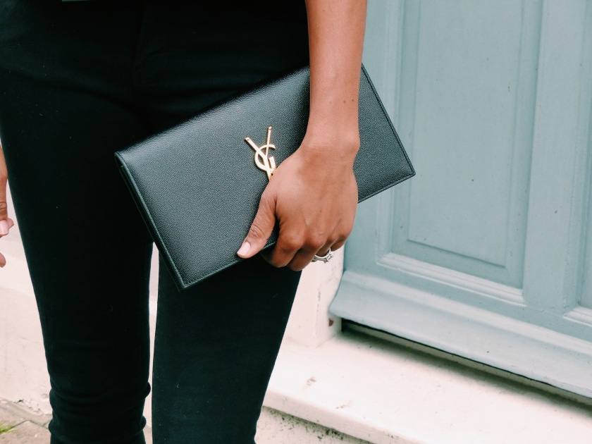 Amanda Luttrell Garrigus carrying a YSL Grain de Poudre clutch