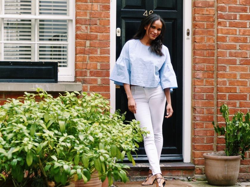 Amanda Garrigus in a blue Zara top in London