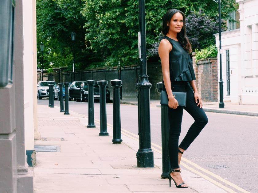 Amanda Luttrell Garrigus in a Frame denim black skinny jean and Zara vegan leather tank