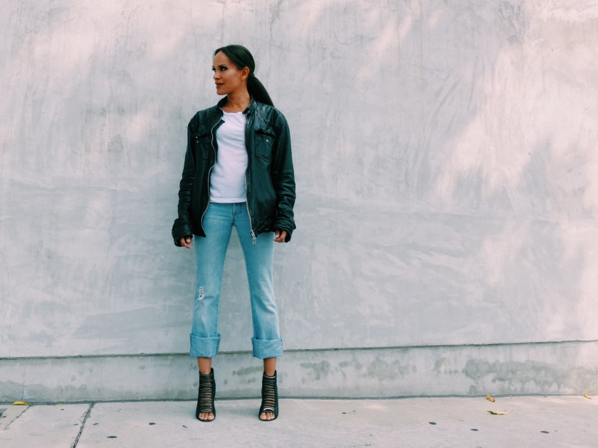 Amanda Luttrell Garrigus in an oversized leather All Saints Jacket and light washed cropped flared jeans