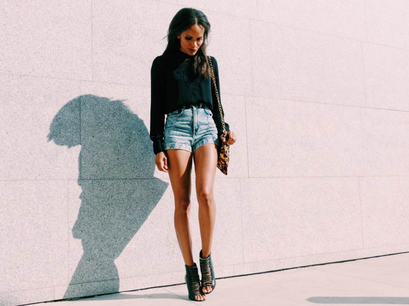 Amanda Luttrell Garrigus wearing high-waisted shorts and carrying a leopard bag