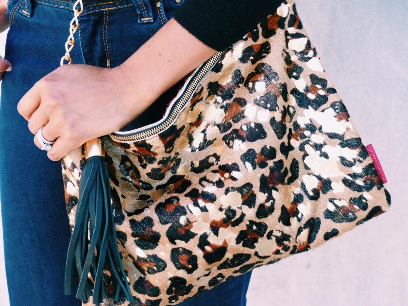 Amanda Garrigus carrying a leopard print bag
