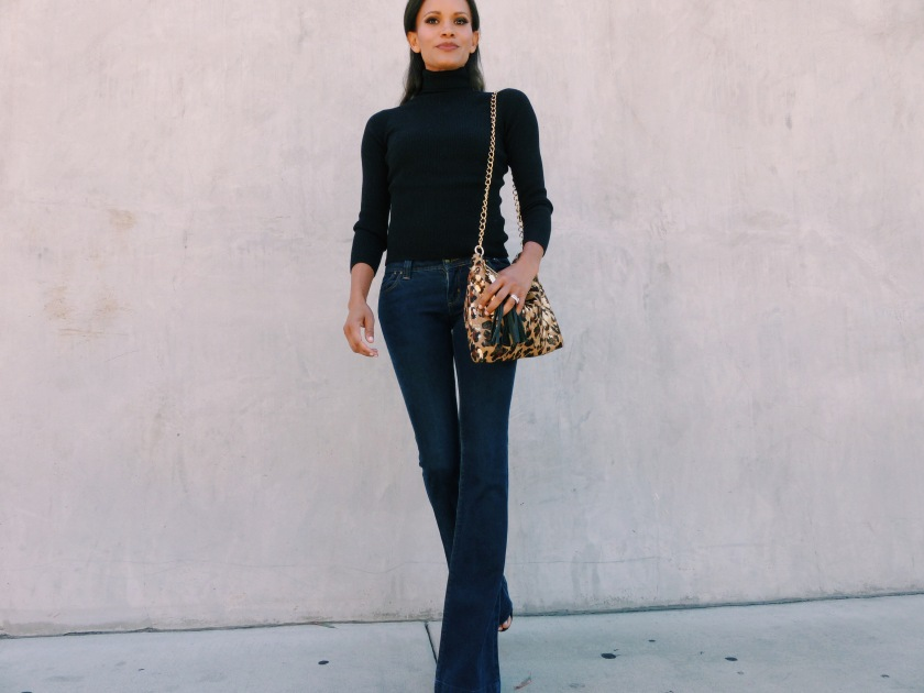 Amanda Luttrell Garrigus wearing a black turtleneck sweater