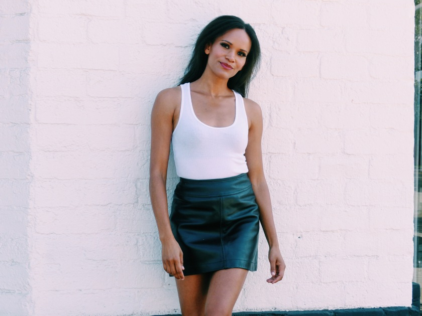 Amanda Luttrell Garrigus wearing a white tank and a black leather mini