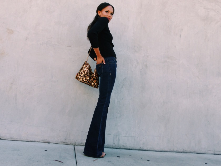 Amanda Luttrell Garrigus wearing flared jeans and a turtleneck sweater