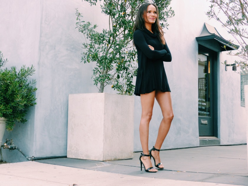 Amanda Garrigus wearing a black jersey turtleneck dress