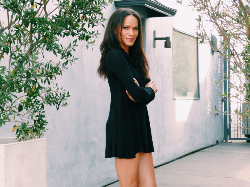Amanda Luttrell Garrigus wearing a turtleneck swing dress